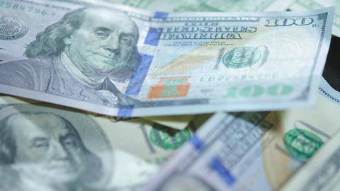 Dollars macro shooting. Money on table. Money slow motion. Franklin. Americans Live Action