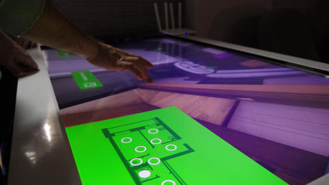 designer works with room visualization on touchscreen gadget Live Action