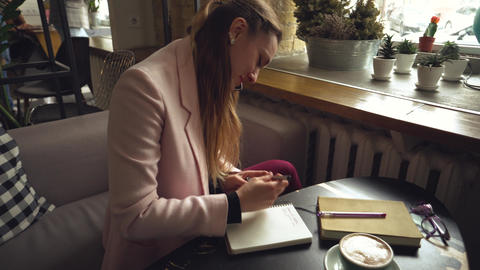 Businesswoman working remotely talking on mobile. Busy businesswoman working in Live Action