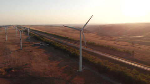 Aerial Sunset. Wind Turbine Power Generators. Clean And Renewable Energy Live Action