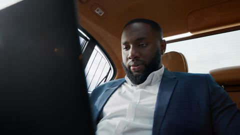 Portrait of puzzled african american man getting bad news at luxury car Live Action