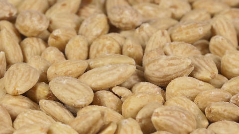 Close-up of almonds on a rotating plate Footage