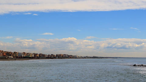 Clouds over the coast. Zoom. Ostia, Rome, Italy. Time Lapse Footage