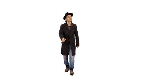 Front view of a man in coat & hat walking & smiling, 4k shot with alpha channel Footage