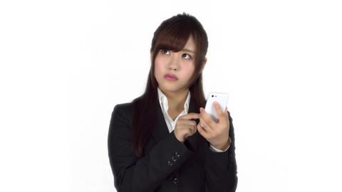 Lost young Japanese business woman using maps on iphone Live Action