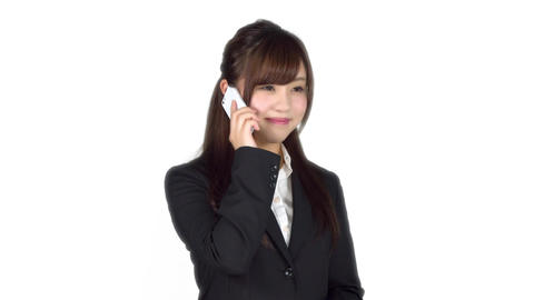 Young Japanese business woman talking on iphone Footage