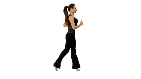 Side view of a young athletic woman is jogging, 4k footage with alpha channel Footage