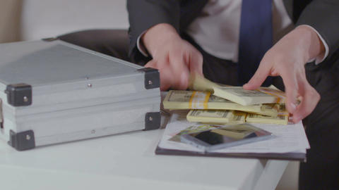 Rich guy takes dollars from briefcase, money obsession, greed Footage
