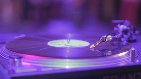Closeup of stylus, vinyl record rotating, music playing at party Footage