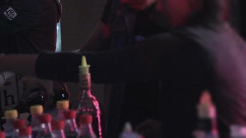 Bartender at work, preparing, serving alcohol drinks to clients Footage
