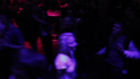 Wild crowd enjoying music, ecstasy dancing, going crazy in club Live Action