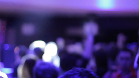 Blurred people on dance floor, jumping, dancing, enjoying music Footage