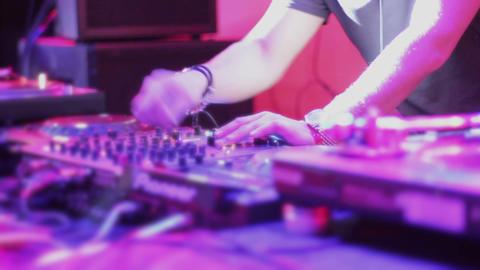 Female DJ hands tweaking controls on professional turntable Footage