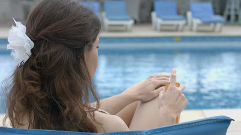 Young woman using sunscreen, having rest, vacation at hotel Footage