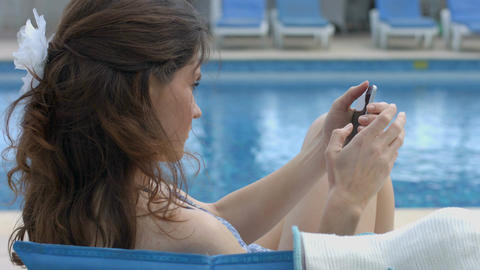 Young female chatting online on smartphone, having summer rest Footage