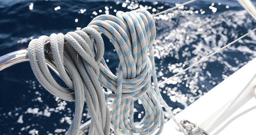 Close-up view of sailboat ropes at sunny weather, pulleys and ropes on the mast Live Action