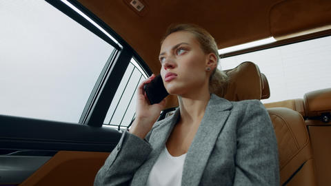 Angry woman calling mobile phone at car. Businesswoman talking phone at vehicle Live Action
