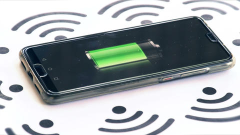 wi-fi charging phone charger rotating with wireless symbols and battery icon Live Action