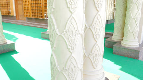 Close-Up of a White Column in the Mosque Live Action