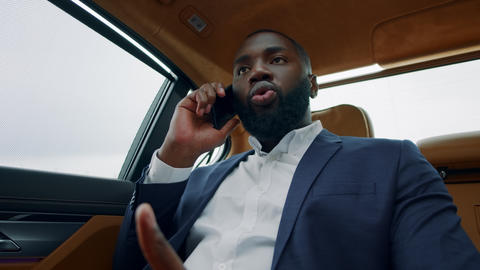 Portrait of business man talking phone at car. Afro man having phone call at car Live Action
