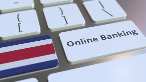 Online Banking text and flag of Costa Rica on the keyboard. Internet finance Live Action