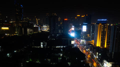 Cars traffic at the streets of illuminated Bangkok at night time timelapse Live Action