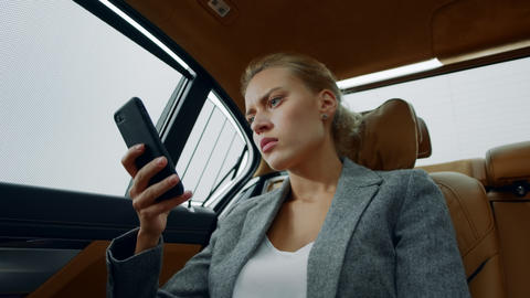 Closeup business woman getting bad news on phone. Sad girl sitting in vehicle Live Action