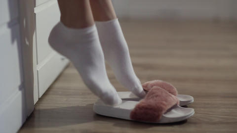 Woman getting out of bed, put on slippers Live Action