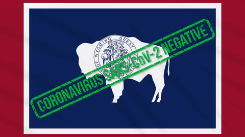 Wyoming US state swaying flag with green stamp of freedom from coronavirus, loop Animation