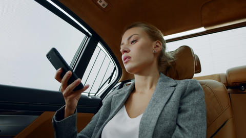 Serious business woman having phone call at car. Tired girl calling mobile phone Live Action