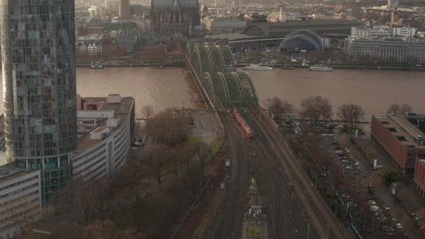 AERIAL: Train crossing Cologne Hohenzollern Bridge on Sunny day with haze in the Live Action