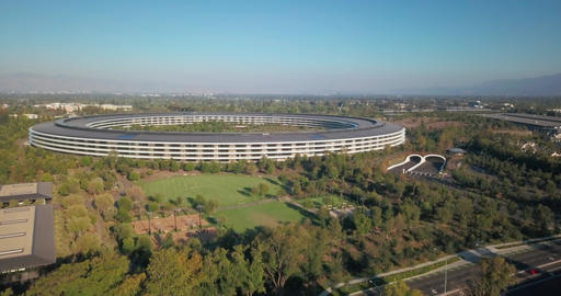 Aerial, descending, panning around the Apple Park, Apple Inc.'s headquarters Live Action