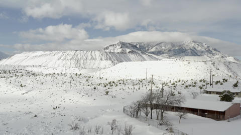 Snow covering Mountain Pass Rare Earth Mine, California, aerial push view Live Action