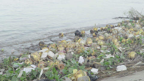Environmental pollution problems: Water pollution. Plastic trash on the banks of Live Action