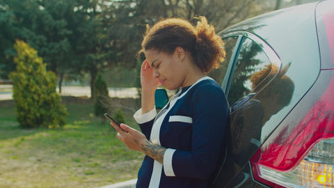 Woman web surfing on phone for roadside assistance Live Action