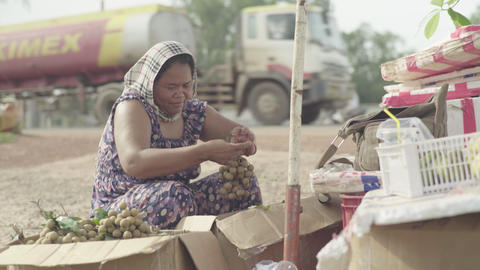 Woman street vendor on the street of Sihanoukville, Cambodia, Asia Live Action