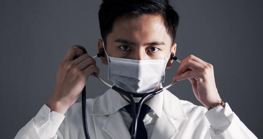 asian young doctor wears white medical coat and holding stethoscope Live影片