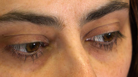 Brown eyes of a girl close-up, different emotions, running and wide open eyes Live Action