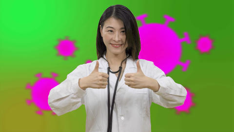 Corona Asian female doctor showing 2 thumbs up in front- Live影片