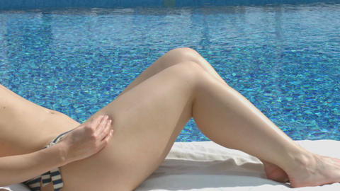 Rich woman with hot body enjoying rest near pool at luxury hotel Footage