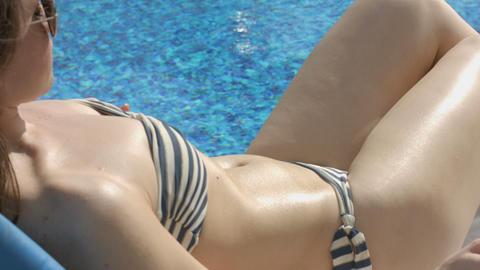 Beautiful female rubbing oil on body. Skin moisturizing, massage Footage