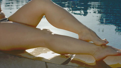 Close-up of seductive female legs near the pool, woman flirting Footage