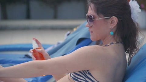 Pretty woman applying sunscreen to protect skin from ultraviolet Footage