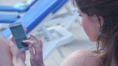 Young female chatting online on smartphone, using application Footage