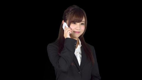 Young Japanese business woman talking on iphone Live Action