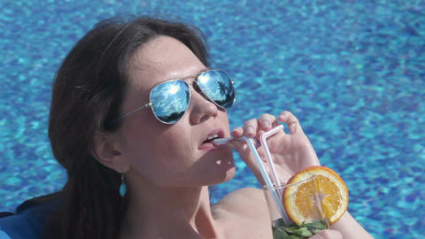 Satisfied woman drinking refreshing cocktail at luxury resort Footage