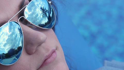Woman enjoying comfort under blanket on beach, face close-up Footage
