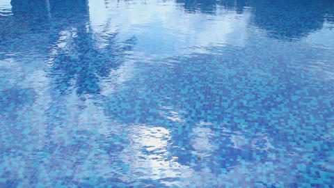 Swimming pool blue water surface. Summer vacation, resort, hotel Footage