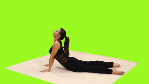 A young athlete woman doing yoga, Full HD footage with alpha channel Footage