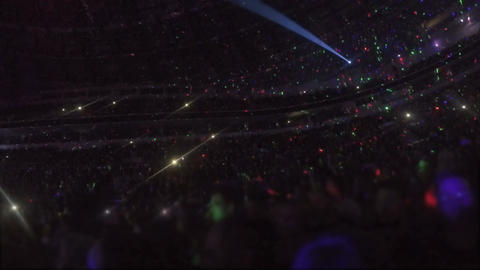 Amazing light effects at arena with thousands of people enjoying music show Footage
